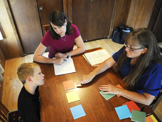 Henry and his mom Patty Gramke work with dyslexia specialist