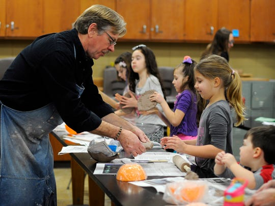 Mike Bladow teaches a clay for kids class during the