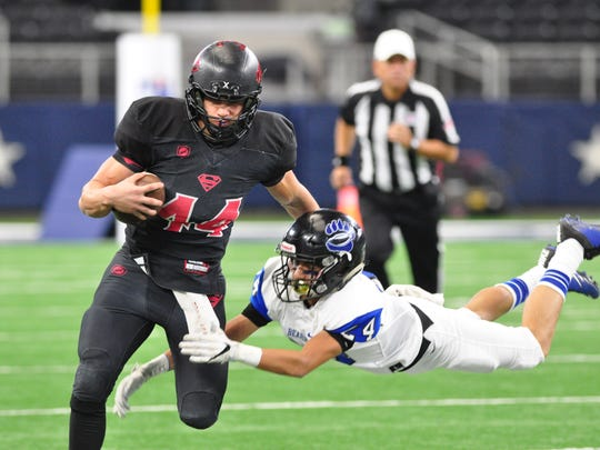 Strawn running back Tanner Hodgkins shakes off Balmorhea defensive back Josiah Garcia to score a touchdown in 2017. This past season, he had an even more dominant defensive season helping the Greyhounds win their second-consecutive state title.