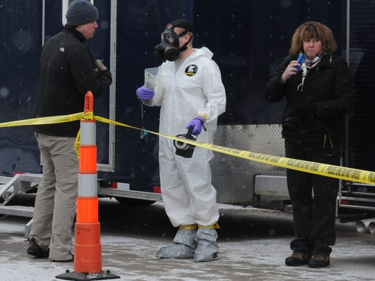 Authorities clean up ricin that was found at a home at 803 Frederick Street in Oshkosh last year.