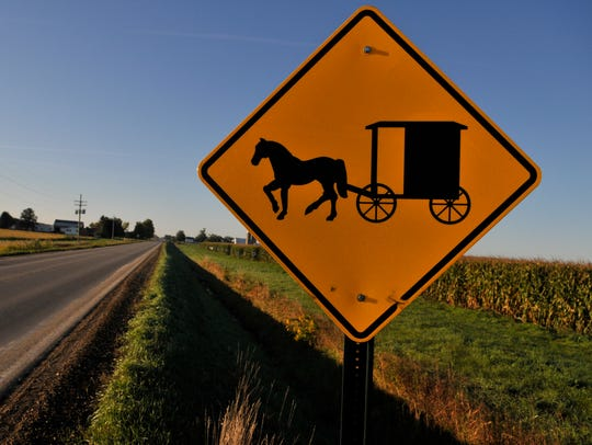 A sign warns motorists of horse-drawn vehicles on Maple