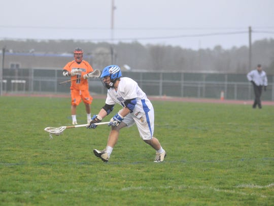 Stephen Decatur junior Dryden Brous scoops up a groundball