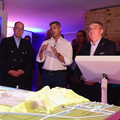 LA 2024 chairman Casey Wasserman (in white shirt) speaks during a presentation to the IOC during the Rio Olympics. To his left is IOC president Thomas Bach and Los Angeles mayor Eric Garcetti.