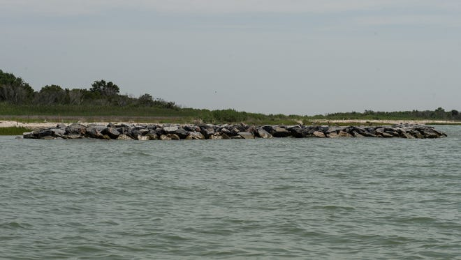 A view of a structure build to prevent beach erosion on Smith Island on Wednesday, July 12, 2017.