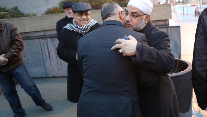 Imam Mohammad Qatanani was greeted by well-wishers before entering U.S. Immigration Court in Newark on Monday, Dec. 5, 2016.
