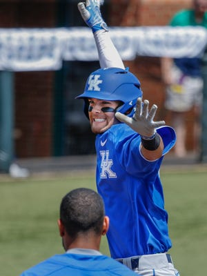 Kentucky's Riley Mahan celebrates after hitting a grand slam against Indiana to give the Cats a 10-1 lead. June 4, 2017