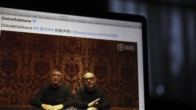 Dolce & Gabbana founders Domenico Dolce, left, and Stefano Gabbana apologize on Chinese social media for controversial ads and insulting remarks.