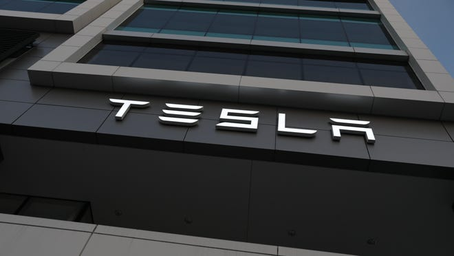 """Saying the road ahead was """"very difficult,"""" Tesla's CEO Elon Musk said Friday that the company would be cutting its staff by about 7 percent."""