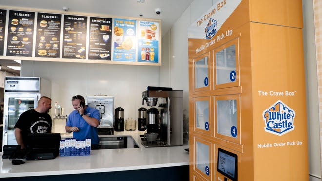 """The mobile order """"Crave Box"""" is seen in 2018 at White Castle, 965 N. High St., in Columbus. Restaurant industry officials say that, for most eateries, carryout and delivery haven't come close to meeting revenue needs. Limited-capacity dining isn't much better."""