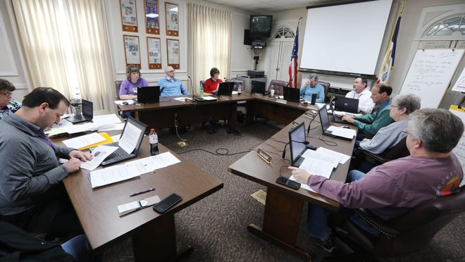 A special meeting of the Burlington School Board concerning the district's possible response to the coronavirus COVID-19 situation is held March 13 in the district's administration building. Board meetings now take place either in the high school library or via Zoom amid increasing rates of infection.