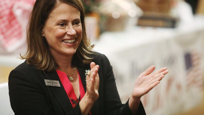 Theresa Greenfield, a candidate for U.S. Senate applauds while listening to remarks made by Rep. Dennis Cohoon, D-Burlington, during the Des Moines County Democrats Boots 'N Jeans fall fundraiser, Thursday Oct. 3, 2019 at Harvest View Farms in Sperry.