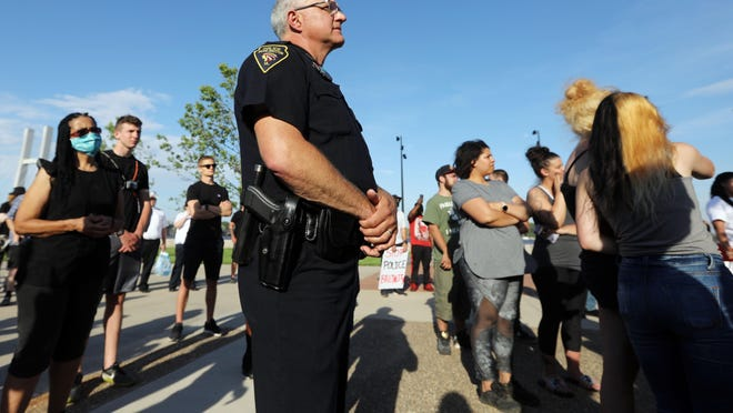 Burlington Police Chief Dennis Kramer attends a peaceful protest in response to the death of George Floyd, who was killed by a Minneapolis police officer, June 2  in Burlington. The protest started at the Burlington Police station before marching down to the riverfront.