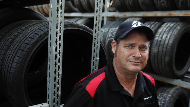 Ed Roberts, of Roberts Tire Center, is shown Monday at the Burlington business at 1220 Mount Pleasant St.