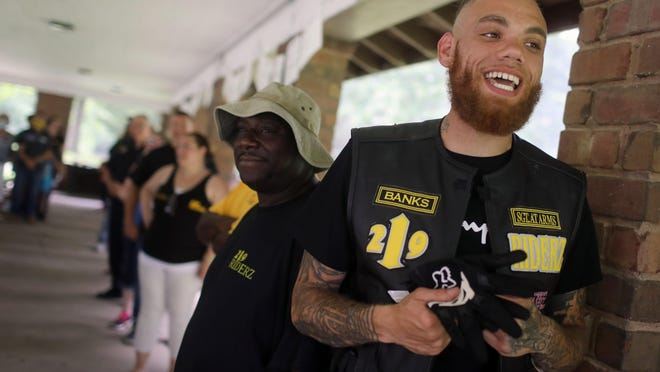 Matthew Banks II, Sgt. at Arms for the Burlington chapter of 219 Riderz motorcycle club, laughs Saturday while playing a game of Would You Rather, during a Juneteenth celebration at the Crapo Park shelter house. Juneteenth commemorates June 19, 1865, when the last slaves were freed in Galveston, Texas. President Abraham Lincoln had signed the Emancipation Proclamation Jan. 1, 1863, but it wasn't until nearly two-and-a-half years later that Union soldiers reached Galveston. Saturday's event, called This is Us, was organized and hosted by three friends: Unity Stevens, Ryland McLaughlin and Tenyshia Chalupa.