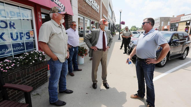 Sen. Chuck Grassley, R-Iowa, tours downtown Main Street with local businessmen and officials following a town hall Tuesday in the Mediapolis City Hall Building.