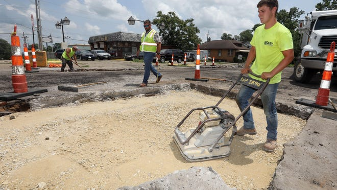 Jarrett Johnson, with Hickey Contracting of Keokuk, uses a packer to smooth out rock while working on concrete patches, as part of the ongoing resurfacing project along Central Avenue between Angular Street and eventually reaching to Harrison Avenue, Thursday in Burlington.