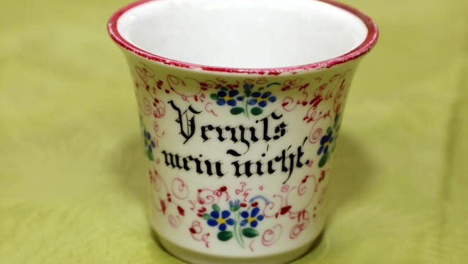 A German cup, an Out of the Attic item, is shown April 3 at the Des Moines County Heritage Center Museum, 501 N. Fourth St. in Burlington. From the Victorian era, it's made of porcelain and is hand painted with forget-me-not flowers and finely drawn abstract lines.