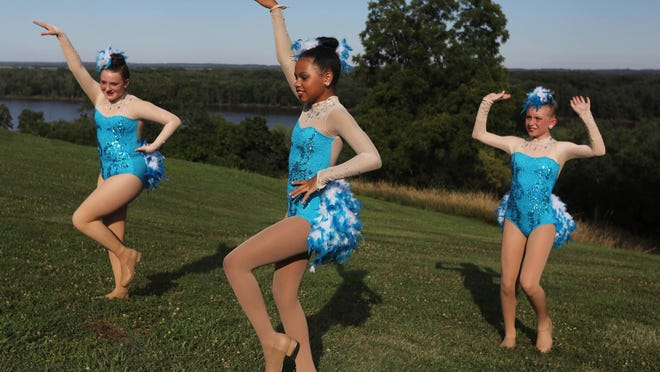 Kyleigh Kniffen, 11, of Burlington, center, and fellow dancers Erin Ryan, 14, of West Burlington, left, and Ellie Weiss, 12, of Burlington, practice their tap routine Thursday while getting ready for Cheryl's School of Dance Performance in the Park dance recital at the Crapo Park Bandshell. The recital was one of two for Cheryl's School of Dance Burlington students. Twenty-two dance routines covering different forms of dance including ballet, tap, pointe and jazz were performed for parents and family members. Another recital is scheduled next week for Cheryl's Mount Pleasant students.