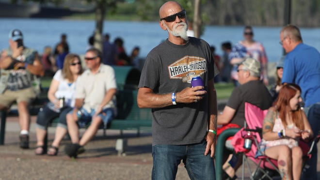 Willee McLeod, a fan of the band Bluzillion, enjoys their permanence July 3 during the first Friday Fest of the season along the Burlington riverfront in front of Memorial Auditorium. The free community event, sponsored by BRE and Pritchard Broadcasting, will be from 5 to 8 p.m. Friday.
