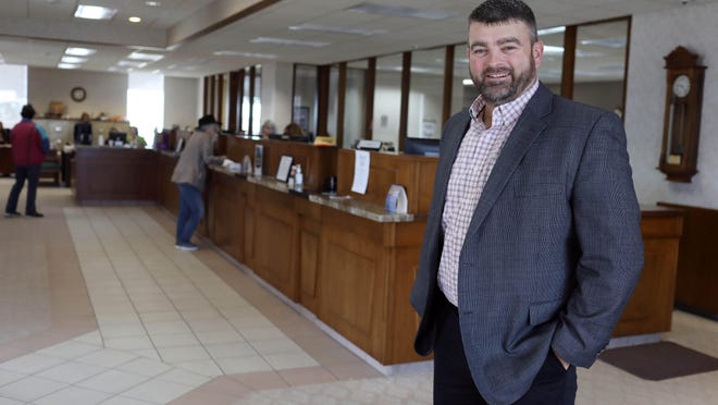 Joel Prottsman, president of the Danville State Savings Bank is shown in the lobby of the bank March 13 at 109 North Main Street in downtown Danville. The lobby will have a different look after the remodel project is done in a couple months.