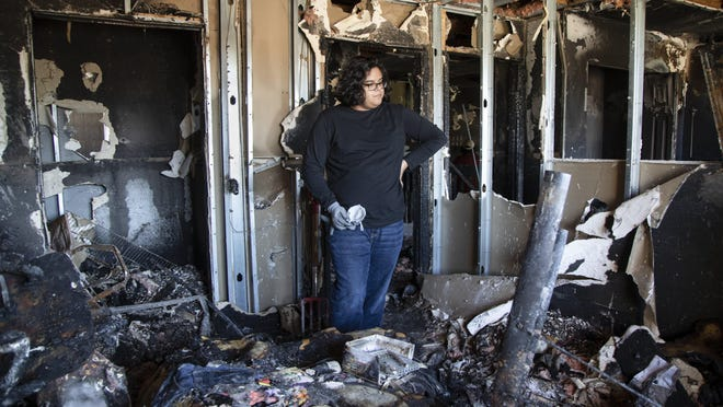 Blake Weis stands in his bedroom that was destroyed by fire on New Year's Eve. Weis, a senior at Dreyfoos School of Arts, lost his art portfolio in the fire that he was going to apply to art school with on January 6, 2020 in Boynton Beach, Florida. [GREG LOVETT /palmbeachpost.com)