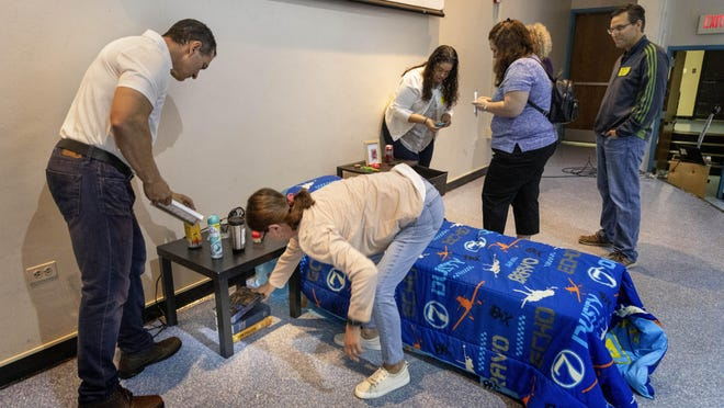 Parents search a mock teen's room looking for contraband from drugs to alcohol during a presentation at Wellington High School in December.