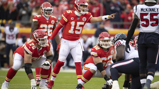 Kansas City Chiefs players, Laurent Duvernay-Tardif (76), Damien Williams (26), and Austin Reiter (62) look on as Chiefs' quarterback Patrick Mahomes (15) gestures during an NFL divisional playoff football game against the Houston Texans in Kansas City, Mo., Sunday, Jan. 12, 2020.