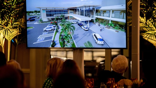 Guests learn the plans for a 90,000 square foot surgical institute planned for Jupiter Medical Center in 2023 during a dinner at the Pelican Club Tuesday in Jupiter on January 21, 2020.