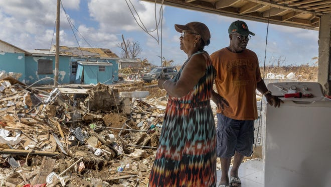 Lynn and Leon Laing stand in whats left of their living room after Hurricane Dorian hit their home of 50 years in Pelican Point on Grand Bahama Island on September 17, 2019.