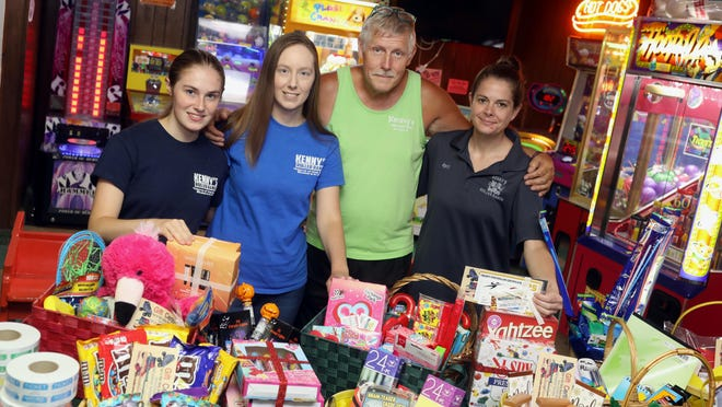 Tim Barraclough, owner of Kenny's Roller Ranch, along with staff members, from left, Jaylee Logan, Sara Johnson and April Foster, are shown Tuesday with some of the gift baskets they put together for an upcoming benefit to help with Spencer Wier's medical expenses at the skating rink in Burlington. Weir was struck by a vehicle on June 9, while riding his bicycle on Summer Street. The benefit will take place from 5 to 8 pm. Sunday at Kenny's Roller Ranch, 8989 Koestler Ave.