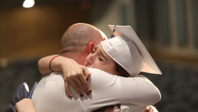 Brianna Graham embraces her father after graduating from Eastridge High School.