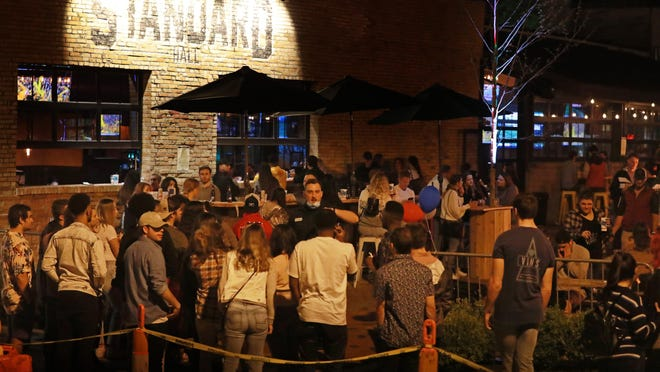 """In spite of COVID-19 crowd limitations, a crowd gathers to drink at Standard Hall, a bar in Columbus' Short North Art District on Friday, May 15, 2020 about 11 pm. The bar's owners, Corso Ventures, told WBNS televsion """"Standard Hall has exactly 45 tables on the patio, spaced 6ft apart. Based on the guidelines set forth by the state, we are not allowing parties of more than 10 at each table."""""""