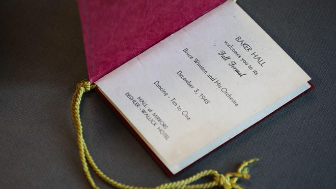 A dance card for the 1948 Baker Hall Fall Formal on Thursday, August 8, 2019 at the Ohio State University Archives in Columbus, Ohio. This artifact was displayed along with several others as part of an anniversary exhibit at Thompson Library.