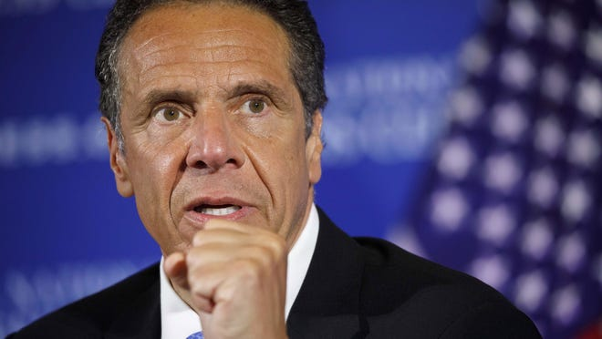 New York Gov. Andrew Cuomo speaks during a news conference in May at the National Press Club in Washington. Travelers from Arizona, Alaska, Delaware, Maryland and Montana will no longer be required to quarantine for 14 days upon arrival, paring back the list of affected states and territories to 31, New York Gov. Andrew Cuomo announced Tuesday.