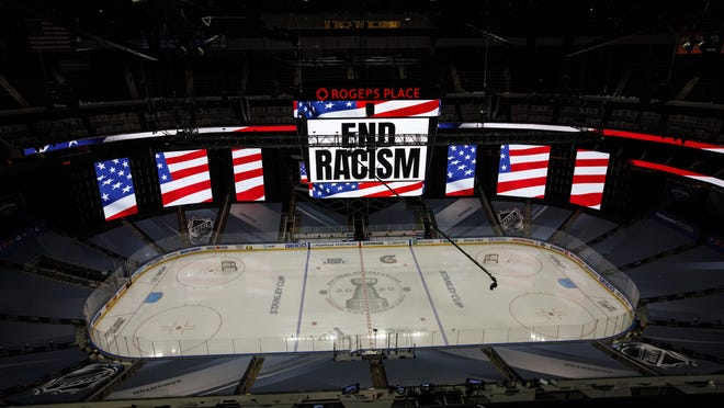 An End Racism sign is displayed before Game 3 of an NHL hockey second-round playoff series between the Colorado Avalanche and the Dallas Stars, Wednesday, Aug. 26, 2020, in Edmonton, Alberta.