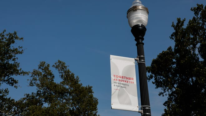 A banner reminds students to socially distance during the first day of fall classes on Tuesday, August 25, 2020 at Ohio State University in Columbus, Ohio. Classes this semester are a mix of virtual and in-person because of the ongoing COVID-19 pandemic. Students wore masks across campus and were reminded to socially distance to prevent the spread of the novel coronavirus.