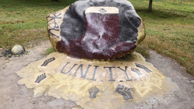 "Kent State students painted the rock Aug. 31 to display Queen Tiye after someone had painted ""White Lives Matter"" on the rock last week. The queen was painted and had been covered with ""WLM"" sometime  the nexr night."