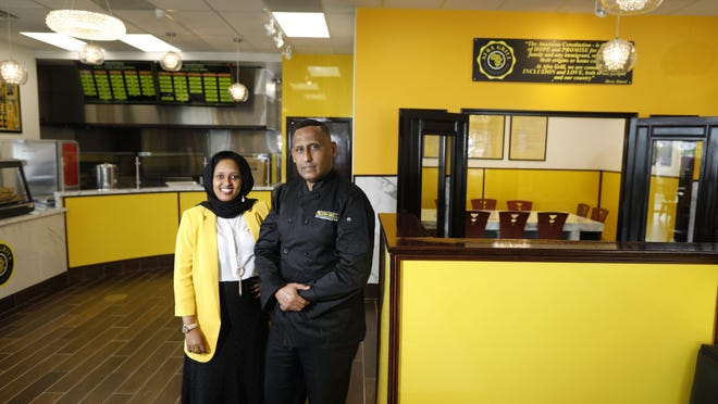 The husband and wife team of Sagal Aden, left, and Abdirahman Ahmed have opened Afra Grill on Morse Road. The restaurant features African-inspired cooking that's American made.