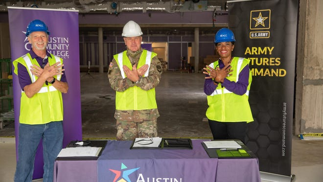 From left, Austin Community College Chancellor Richard Rhodes, U.S. Army Gen. John Murray and ACC trustee Gigi Edwards Bryant celebrate the signing of a collaboration agreement between ACC and Futures Command.