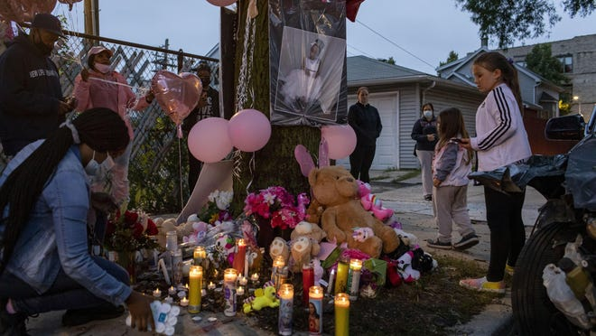 Mourners attend a vigil Sept. 9 in memory of Dajore Wilson, 8, near where she was killed two days earlier in Chicago.