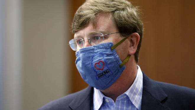 "Gov. Tate Reeves sports a ""Mississippi Strong"" face mask following a coronavirus news briefing in Jackson, Miss."