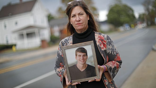 Robyn Houston-Bean of Braintree holds a picture of her son Nick, who died of an overdose at 20 years old. Greg Derr/The Patriot Ledger