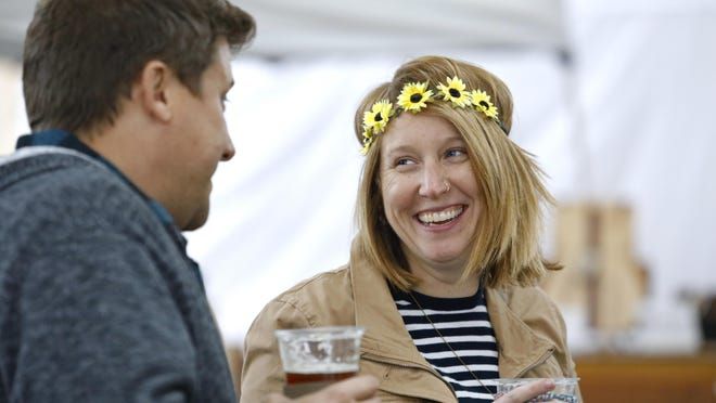 Tim Schwichtenberg, left, of South Beloit, and Heather Shenberger, of Rockford, drink beer Friday, Sept. 28, 2018, during City Market in downtown Rockford. On Friday, June 19, 2020, LaMonica Beverages will begin offering beer at the market, but craft beer vendors won't yet be on-site. Coronavirus restrictions have limited offerings at the market this season.