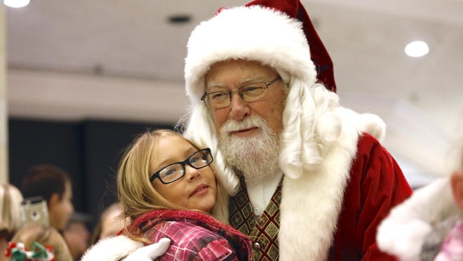 Santa will be at CherryVale Mall this holiday season, but visits will be socially distanced. Nevaeh Buhler, of Rockford, hugs Santa Claus on Nov. 8, 2019, at CherryVale Mall.