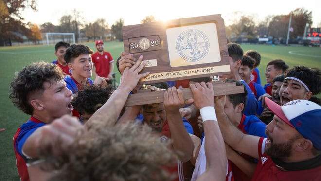 Dodge City raises the Class 6A State Champions trophy after defeating Olathe East 3-0 Saturday at Hummer Sports Park.