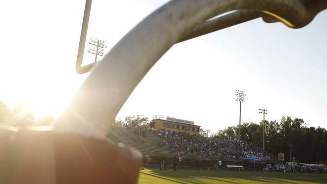 Fans fill in the stands before a high school football game between Clarke Central and Oconee County  in Athens on Friday, Aug. 30, 2019.