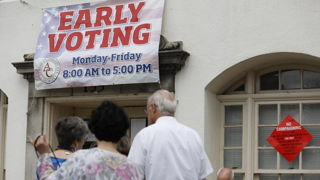 Voters wait in line at the Athens-Clarke County Board of Elections office in downtown Athens to cast their ballots during early voting in March.