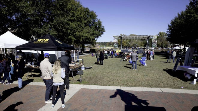 People enjoying music, games and food at the Augusta Brunch Festival at the Augusta Common on Saturday, November 9, 2019.