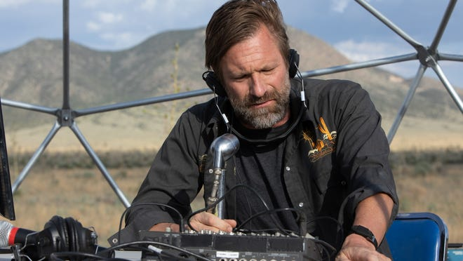 Arthur (Aaron Eckhart) does more than just talk about conspiracy theories.