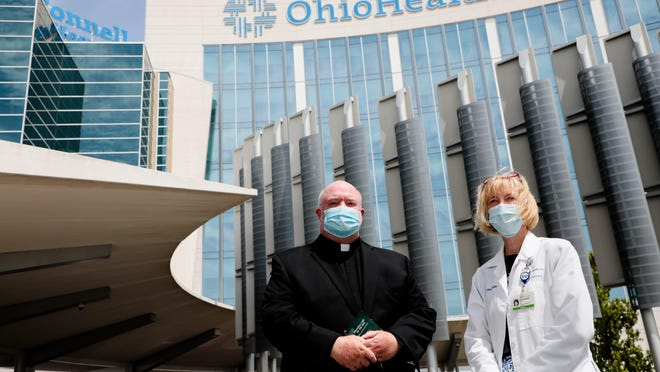 Father Michael Lumpe and Dr. Marian Schuda, OhioHealth medical director of patient services, have helped guide priests through changes in giving last rites during the COVID-19 pandemic.